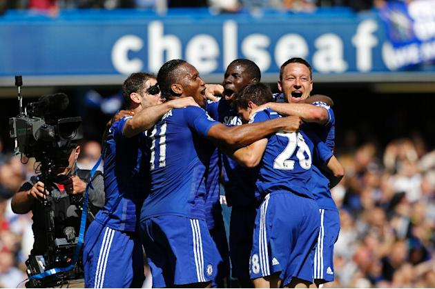John Terry (right) celebrates Chelsea's Premier league title with (left to right) Branislav Ivanovic, Didier Drogba, Kurt Zouma and Cesar Azpilicueta