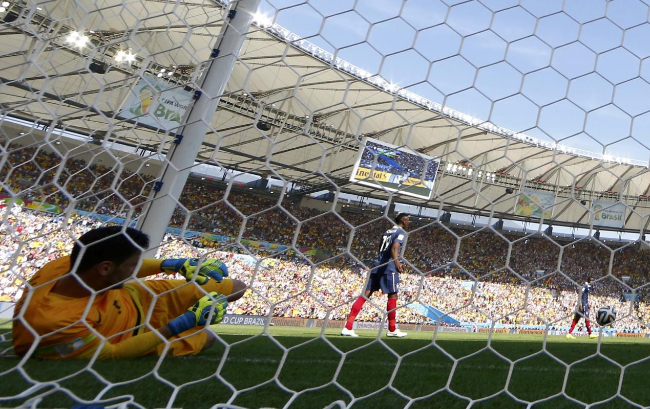 France's goalkeeper Hugo Lloris reacts after Germany's Mats Hummels scores a goal during their 2014 World Cup quarter-finals at the Maracana...