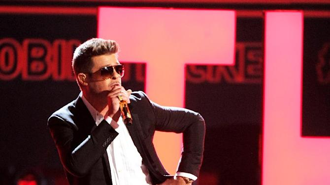 Robin Thicke performs at the BET Awards at the Nokia Theatre on Sunday, June 30, 2013, in Los Angeles. (Photo by Frank Micelotta/Invision/AP)
