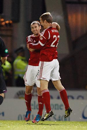 Niall McGinn, left, scored deep into the second half for Aberdeen