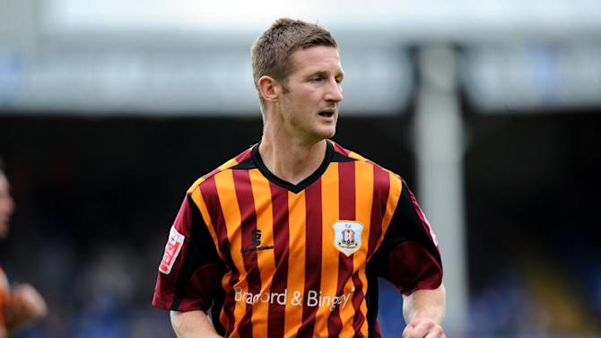 York have secured the signature Bradford midfielder Lee Bullock
