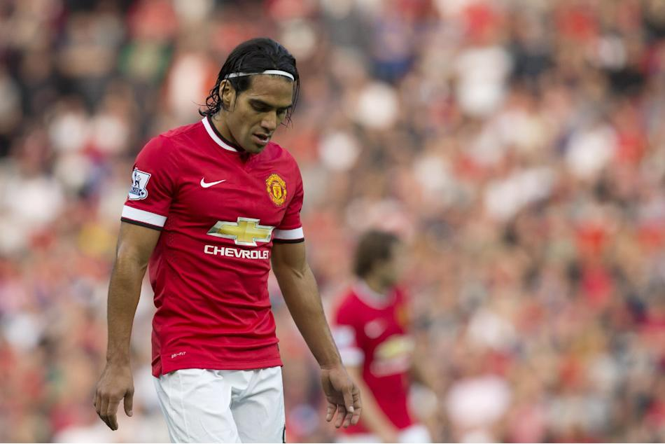 FILE - In this Sept. 14, 2014 file photo, Manchester United's Radamel Falcao Garcia walks on the field during his team's English Premier League soccer match at Old Trafford Stadium in Manchest