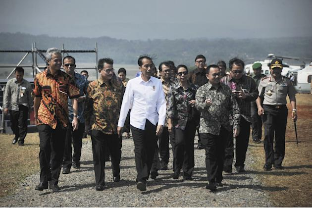 Widodo arrives for the inauguration of a power plant project in Ujung Negoro