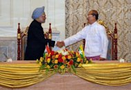 Visiting Indian Prime Minister Manmohan Singh (left) shakes hands with Myanmar President Thein Sein during their meeting at the president's house in Naypyidaw. India has agreed a raft of deals with Myanmar during a visit by Singh that is aimed at boosting trade and energy links and contesting the influence of regional rival China