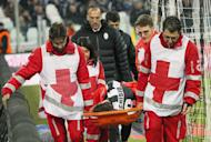 Juventus' Claudio Marchisio is carried off the playing field by medical staff after being injured during their Italian Serie A match against Sampdoria, at the Juventus Stadium in Turin, on January 6, 2013