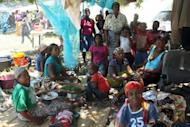A group of mostly women, children and elderly people who escaped floods in southern Mozambique gather at a camp set up for displaced people on January 24, 2013 in Chokwe district. Flooding in Mozambique has killed at least 17 people and displaced tens of thousands more, according to United Nations figures, with a fresh storm surge feared Friday