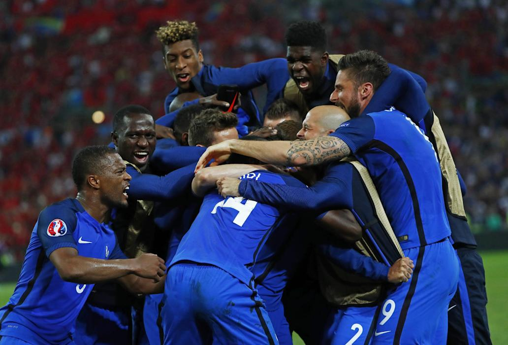 France's Antoine Griezmann celebrates with team mates after scoring their first goal