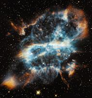The swirling gas of nearby planetary nebula NGC 5189 looks like a Christmas-tree ornament with a glowing ribbon inside.