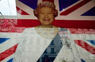 A portrait of Queen Elizabeth II, which is made of Lego pieces, hangs in the window of a shop in London on May 21. Millions will celebrate the queen's diamond jubilee as the monarch marks 60 years on the throne in the knowledge that the royal family has never been more popular