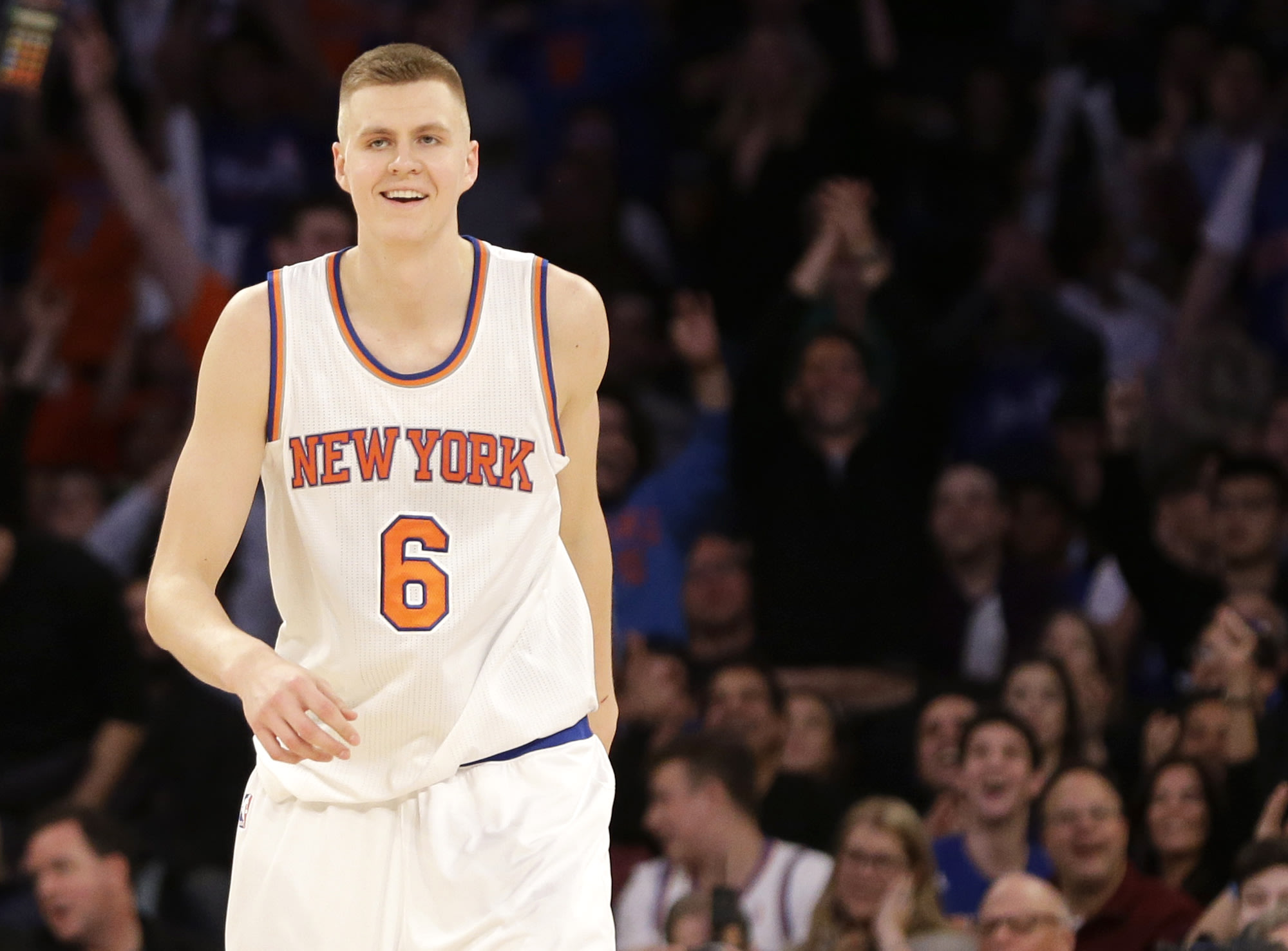 Kristaps Porzingis smiles after putting away another crook. Or hitting a shot. Whichever. (AP)