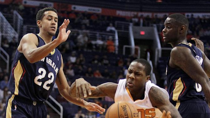 Phoenix Suns guard Archie Goodwin (20) loses the ball between New Orleans Pelicans guard Brian Roberts (22) and  guard Anthony Morrow (3) in the fourth quarter during an NBA basketball game on Sunday, Nov. 10, 2013, in Phoenix. The Suns defeated the Pelicans 101-94