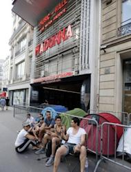 Fans of US singer Madonna camp next to the Olympia concert hall in Paris on Wednesday, a bay before her concert. The angry reaction on Friday to her short show was in sharp contrast to the enthusiastic cheers which greeted Madonna when she exited the stage at the Olympia theatre after barely three quarters of an hour on Thursday evening