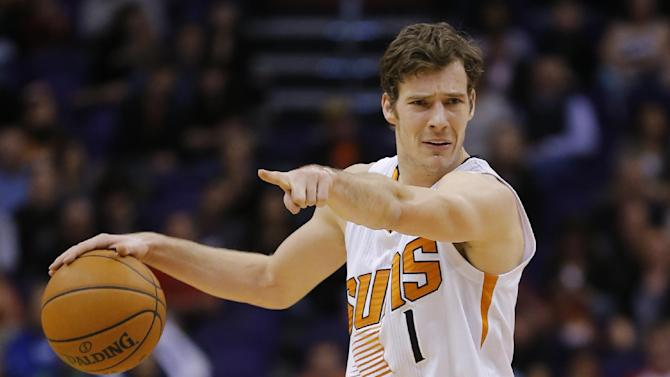 Phoenix Suns' Goran Dragic, of Slovenia, directs his teammates against the Memphis Grizzlies' during the second half of an NBA basketball game on Thursday, Jan. 2, 2014, in Phoenix. The Grizzlies won 99-91