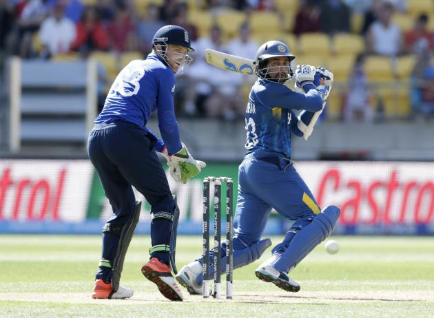 England's Buttler watches as Sri Lanka's Dilshan hits a boundary during their Cricket World Cup match in Wellington