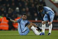 Britain Football Soccer - AFC Bournemouth v Manchester City - Premier League - Vitality Stadium - 13/2/17 Manchester City's Gabriel Jesus sits after sustaining an injury as David Silva looks on Reuters / Peter Nicholls Livepic
