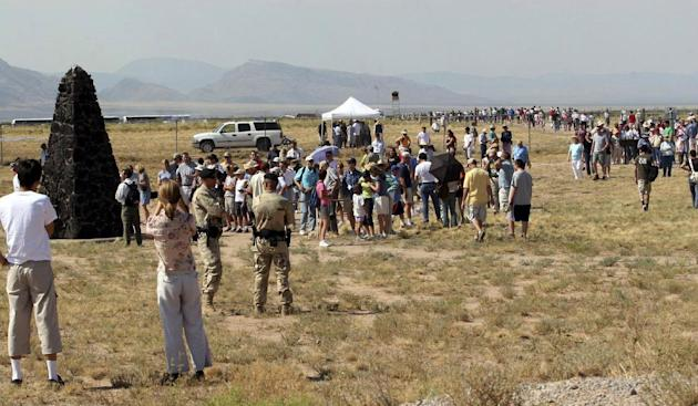 FILE -  In this Saturday, July 16, 2005 file photo, a crowd of visitors gathers at the Trinity Site, where the first atomic bomb was tested 60 years ago, at White Sands Missile Range, N.M. Seven decad