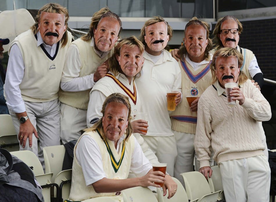 Spectators wearing masks of Botham, pose for a photograph during the third one-day international between England and Australia in Birmingham
