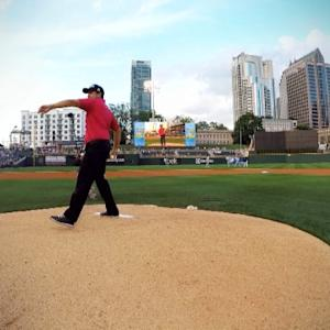 Erik Compton tosses the first pitch