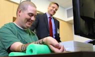 Quadriplegic Moves Hand With Brain Microchip