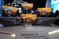 Photo illustration shows Samsung OLED TVs displayed at an electronics show. South Korean and German police are probing the disappearance of two next-generation Samsung TVs en route to Berlin, the company said Tuesday, amid suspicions of commercial espionage