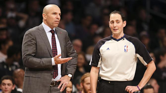 Brooklyn Nets head coach Jason Kidd, left, argues with referee Marat Kogut in the second half of an NBA basketball game against the Los Angeles Lakers at the Barclays Center, Wednesday, Nov. 27, 2013, in New York. The Lakers defeated the Nets 99-94