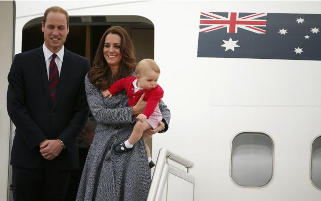 Britain's Catherine, the Duchess of Cambridge, stands with her husband Prince William, as she holds her son Prince George before they depart Canberra