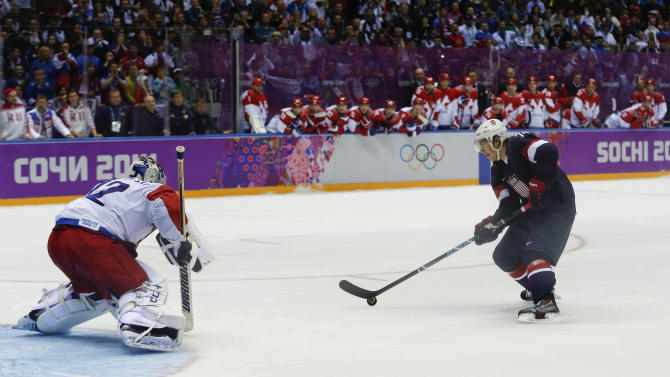 USA forward T.J. Oshie prepares to take a shot againstRussia goaltender Sergei Bobrovski in an overtime shootout during a men's ice hockey game at the 2014 Winter Olympics, Saturday, Feb. 15, 2014, in Sochi, Russia. Oshie scored the winning goal and the USA won 3-2