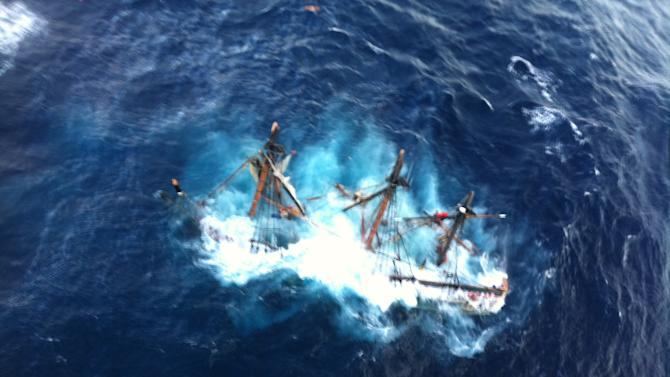 FILE - This undated file photo provided by the U.S. Coast Guard shows the HMS Bounty, a 180-foot sailboat, submerged in the Atlantic Ocean during Hurricane Sandy approximately 90 miles southeast of Hatteras, N.C., Monday, Oct. 29, 2012. Surviving crew members will testify as a federal safety panel meets Tuesday, Feb. 12, 2013 in Portsmouth, Va. to examine what led to the sinking of the replica 18th-century sailing ship during Hurricane Sandy. One member of the HMS Bounty's crew died and the captain was never found after the ship sank 90 miles off Cape Hatteras, N.C., during the October storm. (AP Photo/U.S. Coast Guard, Petty Officer 2nd Class Tim Kuklewski, File)
