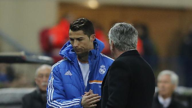 Real's Cristiano Ronaldo shakes hands with coach Carlo Ancelotti, right, during a semi final, 2nd leg, Copa del Rey soccer match between Atletico de Madrid and Real Madrid at the Vicente Calderon stadium in Madrid, Spain, Tuesday, Feb. 11, 2014