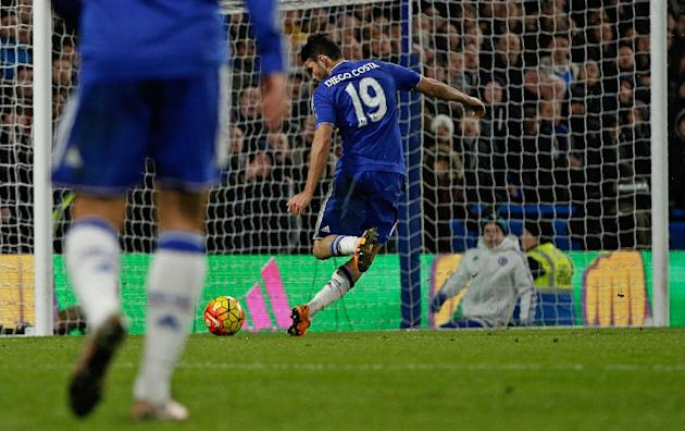 Chelsea's Diego Costa shoots and scores during the match against Manchester United at Stamford Bridge in London on February 7, 2016