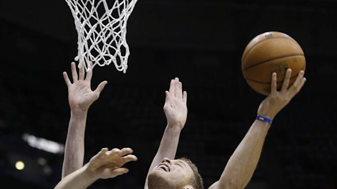 Los Angeles Clippers' Blake Griffin (32) puts up a shot against Milwaukee Bucks' Ersan Ilyasova, back, during the first half of an NBA basketball game, Monday, Jan. 27, 2014, in Milwaukee