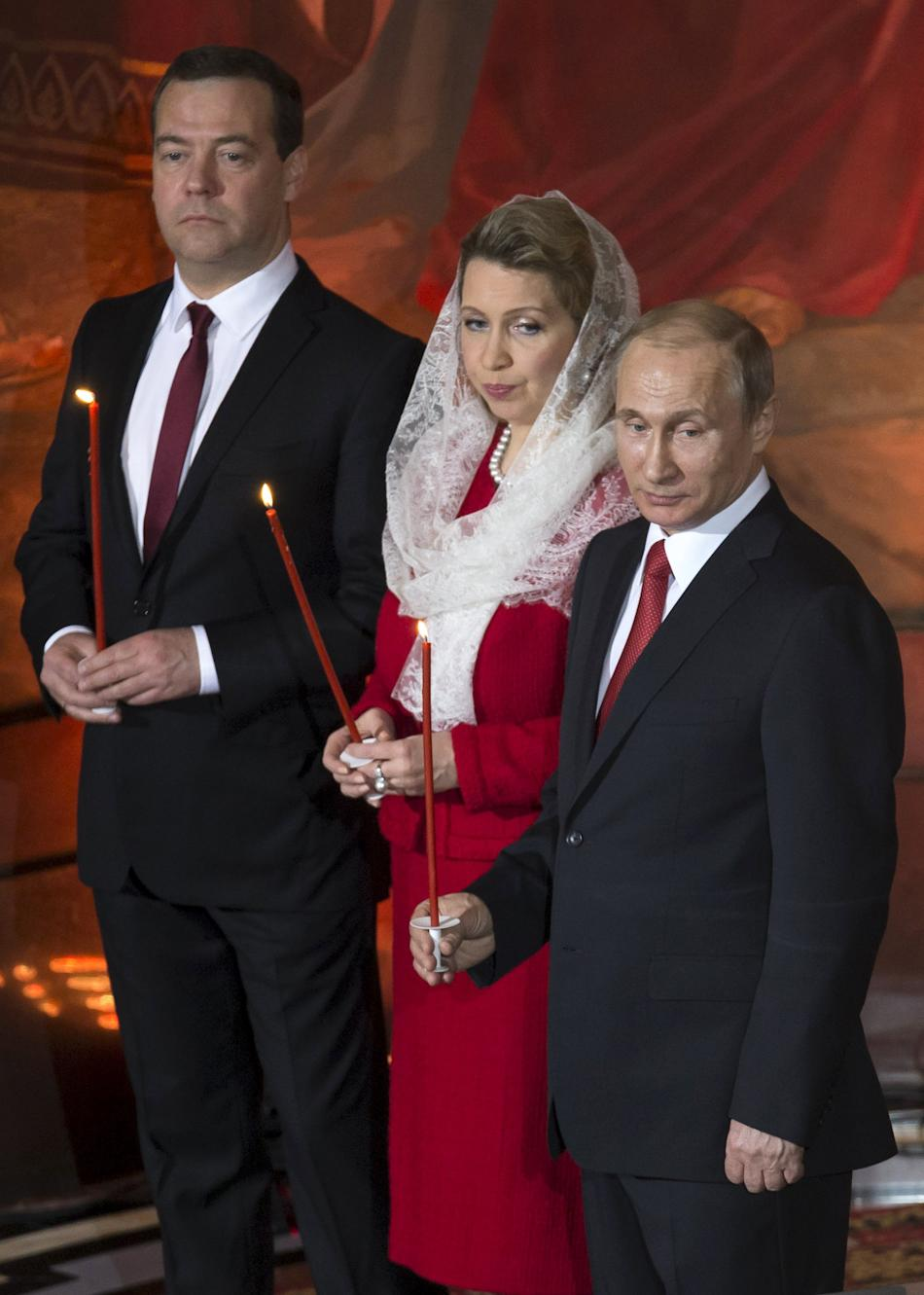 Russian President Putin, PM Medvedev and his wife Svetlana attend the Orthodox Easter service in Moscow