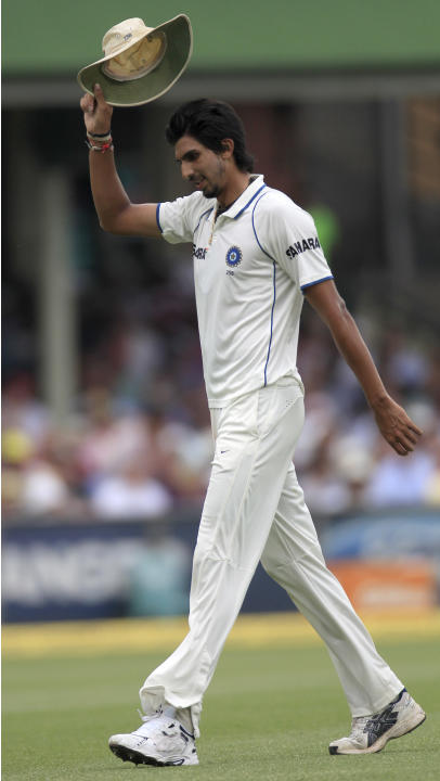 India's bowler Ishant Sharma raises his hat to sarcastic cheers from the crowd after giving up 100 runs against Australia on the second day in their cricket test match at the Sydney Cricket Ground in