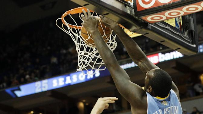 Minnesota Timberwolves' Nikola Pekovic, left, of Montenegro, looks on as Denver Nuggets' J.J. Hickson dunks in the second half of an NBA basketball game on Wednesday, Nov. 27, 2013, in Minneapolis. The Nuggets won 117-110