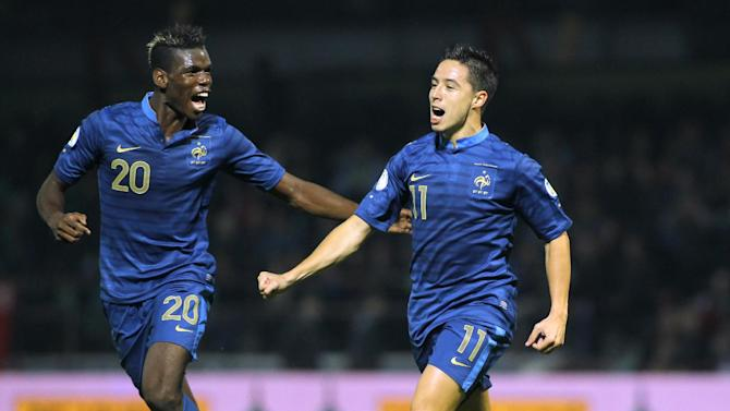 France's Samir Nasri, right, and Paul Pogba celebrate scoring during their World Cup Group I, qualifying soccer match against Belarus in Gomel, Belarus, Tuesday, Sept. 10, 2013