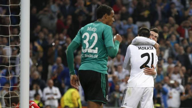 Real Madrid's Morata is congratulated by teammate Bale after scoring a goal against Schalke 04's goalkeeper Fahrmann and Matip during their Champions League last 16 second leg soccer match at Santiago Bernabeu stadium in Madrid