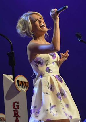 Carrie Underwood performs onstage in celebration of her 5th anniversary at The Grand Ole Opry in Nashville on June 7, 2013 -- Getty Premium