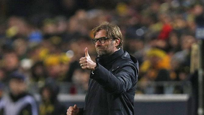 Dortmund head coach Juergen Klopp gives a thumbs-up during the Champions League group F soccer match between Borussia Dortmund and Arsenal FC in Dortmund, Germany, Wednesday,Nov.6,2013