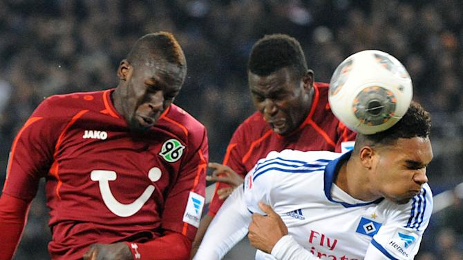 Hamburg's Jonathan Tah , right,  vies for the ball with Hannover's Salif Sane, left,  and Mame Diouf during the German Bundesliga soccer  match between Hamburger SV and Hannover 96 at Imtech Arena in Hamburg,Germany, Sunday Nov. 24, 2013