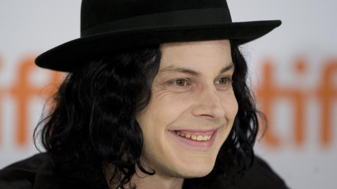 FILE - This Sept. 18, 2009 file photo shows musician Jack White taking part in a news conference in Toronto.  The operators of Detroit's historic Masonic Temple announced Tuesday, June 4, 2013, that White made a $142,000 donation to cover the delinquent tax bill for the prominent music venue that has hosted such groups as The Who and the Rolling Stones over the decades. (AP Photo/The Canadian Press, Darren Calabrese)
