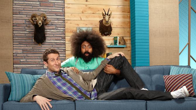 "This undated image released by IFC TV shows host Scott Aukerman, left, and his sidekick Reggie Watts from the IFC-TV late-night talk show ""Comedy Bang! Bang!""  The show premieres Friday at 10p.m. EST on IFC. (AP Photo/IFC-TV, Robyn VonSwank)"