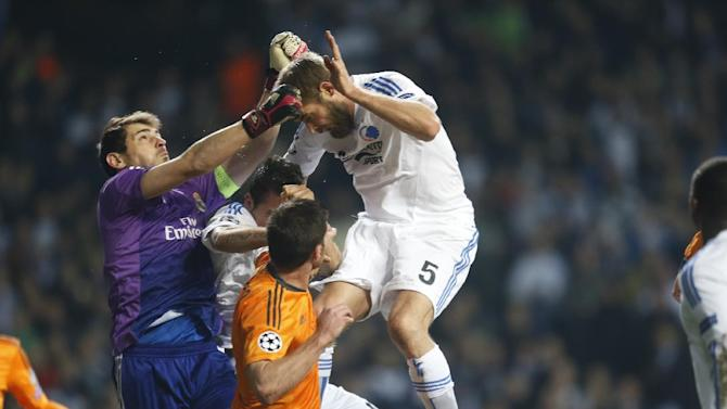 Real Madrid's goalkeeper Iker Casillas and FC Copenhagen's Olof Mellberg vie for the ball during the Champions League, Group B, soccer match between FC Copenhagen and Real Madrid, at Parken in Copenhagen, Denmark, Tuesday Dec. 10, 2013
