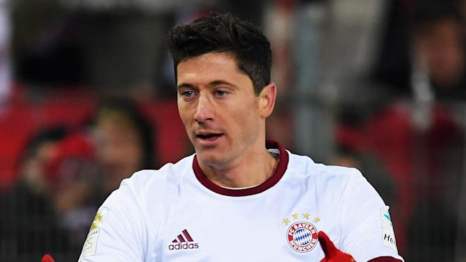 Lewandowski nets 135th Bundesliga goal as Bayern treble omens emerge
