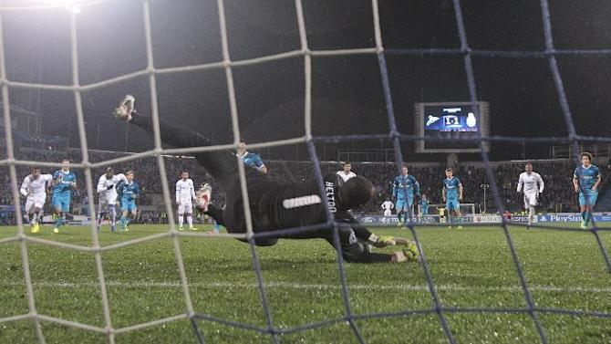 Porto's goalkeeper Helton makes a save on Zenit's Hulk's penalty kick during the Champions League group G soccer match between Zenit and Porto at Petrovsky stadium in St. Petersburg, Russia, Wednesday, Nov. 6, 2013