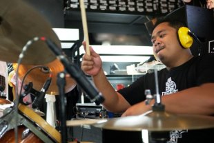 ...and as Giniling Festival's kick-ass drummer (Photo by Francis Brew)