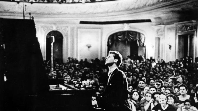 In this photo provided by the Van Cliburn Foundation, Texas pianist Van Cliburn performs to a packed audience in the Great Hall of the Moscow Conservatory in Moscow, Russia, in April 1958 during the first International Tchaikovsky Competition, which he won.  Van Cliburn has been diagnosed with advanced bone cancer and is resting comfortably at his Texas home, his publicist said Monday Aug. 27, 2012.  (AP Photo/Courtesy of Van Cliburn Foundation, file)