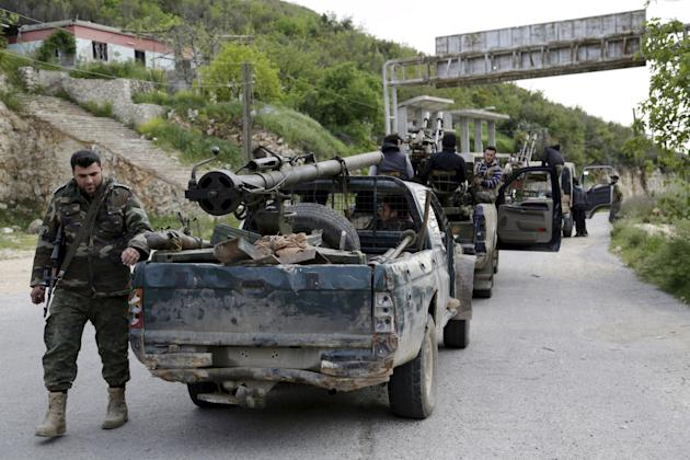 Rebel fighters prepare to head towards what they said was offensive to take control of Jisr al-Shughour and surrounding areas, controlled by forces loyal to President Assad