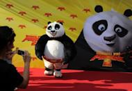 "The Panda poses for photographers as it arrives for the premiere of the film ""Kung Fu Panda 2"" in Berlin on June 7, 2011. DreamWorks Animation, creators of Kung Fu Panda, on Tuesday said it plans to build a $3.2 billion ""entertainment zone"" in Shanghai, as the US film giant seeks to bolster its presence in the booming Chinese market"