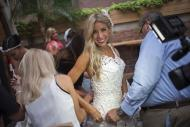 Designer and model Susan Brennan of Orchard Lake, Michigan is helped by assistants ahead of the 10th annual toilet paper wedding dress contest in Midtown, New York June 12, 2014. REUTERS/Adrees Latif