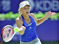 Caroline Wozniacki of Denmark returns the ball to Kaia Kanepi of Estonia during the final match of the KDB Korea Open tennis championships in Seoul. Wozniacki defeated Kanepi 6-1, 6-0